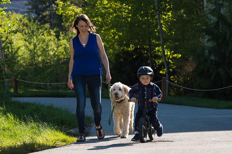 Mom and Boy Walking Dog